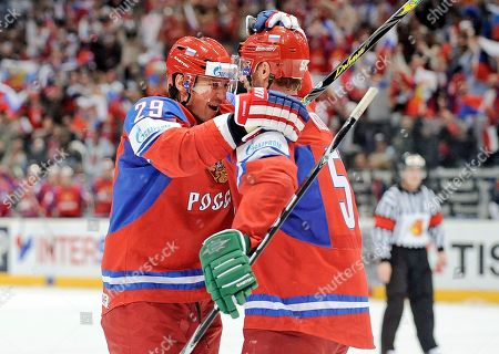 Sergei Fedorov, Viktor Kozlov Russia's scorer Sergei Fedorov, left, celebrates after his opening goal with assistant Viktor Kozlov during the Qualifying Round Group E match between Russia and Finland at the World Ice Hockey Championships in Cologne, Germany
