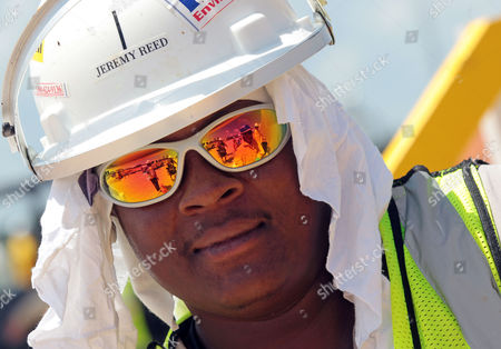 Jeremy Reed supervises oil boom decontamination work at the Theodore Staging Area in Theodore, Ala., . Oil from the Deepwater Horizon disaster continues to wash ashore along the Alabama and Florida coasts and Reed and other workers spend 12 hours a day cleaning oil booms