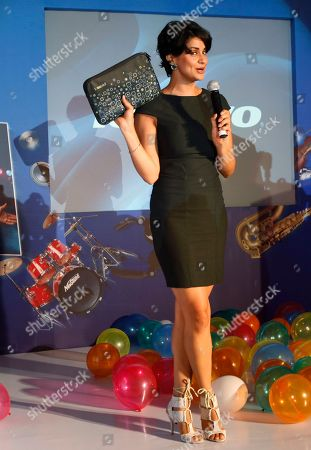 Gul Panag Bollywood actress Gul Panag holds a Lenovo notebook gifted to her by Lenovo India Managing Director Amar Babu, unseen, during a launch event in Bangalore, India, . Lenovo launched a series of new laptops, notebooks and desktops Wednesday