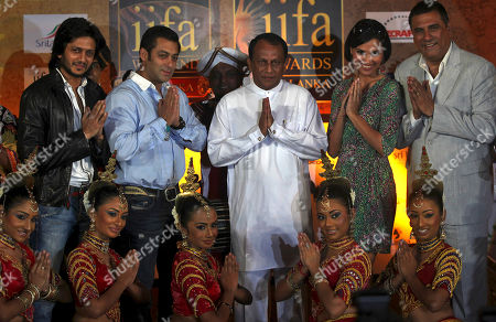 Standing left to right: Bollywood actors Ritesh Deshmukh, Salman Khan, Sri Lankan Deputy Minister of Economic Development Lakshman Yapa Abeywardena, actress Lara Dutta and actor Boman Irani pose for a photograph with Sri Lankan artists in Mumbai, India, . The news conference was held to promote the International Indian Film Academy (IIFA) which will be held later in the year in Sri Lanka