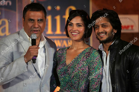 Bollywood actor Boman Irani, left, speaks as fellow actors Lara Dutta and Ritesh Deshmukh look on during a press conference in Mumbai, India, . The news conference was held to promote the International Indian Film Academy (IIFA) which will be held later in the year in Sri Lanka