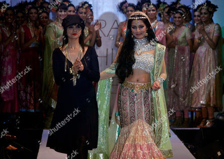 Celina Jaitley Bollywood actress Celina Jaitley displays a creation by Neeta Lulla, left, during the last day of the Hyderabad Fashion Week in Hyderabad, India