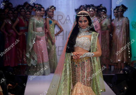 Stock Picture of Celina Jaitley Bollywood actress Celina Jaitley displays a creation by Neeta Lulla during the last day of the Hyderabad Fashion Week in Hyderabad, India