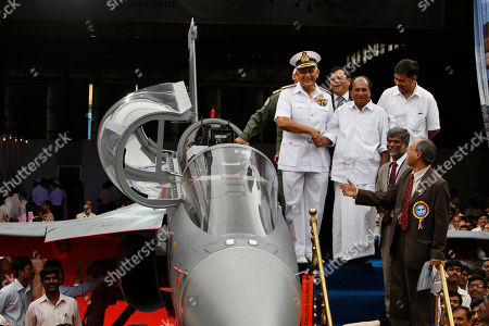 A.K. Antony, Nirmal Verma Indian Defense Minister A.K.Antony, second right, shakes hands with Indian Naval Chief Nirmal Verma during the roll out ceremony of India's first indigenous naval Light Combat Aircraft LCA (Navy) NP1 in Bangalore, India, . The LCA (Navy) NP1 is capable of operation from an aircraft carrier and is now ready to undergo the phase of systems integration tests leading to ground runs, taxi trials and flight