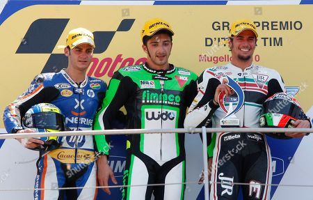 Italy's Andrea Iannone, center, winner of the Italian Moto2 grand prix, poses on the podium with second placed Spain's Sergio Gadea, left, and Italy's Simone Corsi, at the Mugello circuit, in Scarperia, Italy