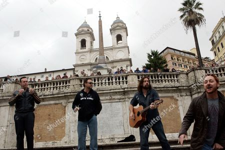 """Russell Crowe From left, Actors Kevin Durand, Russell Crowe, Alan Doyle and Scott Grimes, all starring in Ridley Scott's new movie """"Robin Hood"""" perform on the Spanish Steps in Rome"""