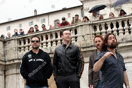 """Russell Crowe From left, Actors Russell Crowe, Kevin Durand, Scott Grimes and Alan Doyle, all starring in Ridley Scott's new movie """"Robin Hood"""" pose on the Spanish Steps in Rome"""