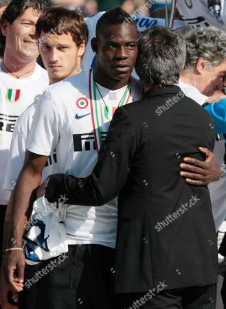 Inter Milan coach Jose Mourinho, back to camera, hugs Mario Balotelli at the end of the soccer match between Siena and Inter Milan in Siena, Italy, . Inter Milan beat Siena 1-0 Sunday to seal its fifth consecutive Serie A title and move two-thirds of the way to a possible treble. Inter finished with 82 points, two more than AS Roma, which won 2-0 at Chievo Verona