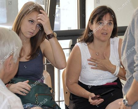 Deanna Knox, left, and Edda Mellas, respectively sister and mother of US murder suspect Amanda Knox, wait at Perugia tribunal, Italy, . Edda Mellas is in Perugia for a pre-trial hearing as she faces charges of slander for stating that Amanda was beaten after her arrest in an interview she gave with her divorced husband to a British newspaper