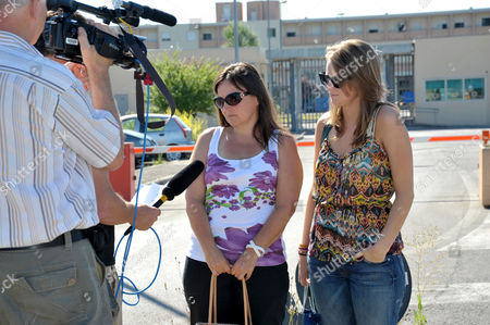 Deanna Knox, right, and Edda Mellas, left, respectively sister and mother of US murder suspect Amanda Knox, are interviewed as they arrive at Perugia prison, Italy, . Edda Mellas and Deanna visited Amanda, who today turns 23-years old, and has been in an Italian jail for three years