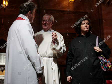 Maria Vittoria Longhitano looks onprior to the start of a mass at the All Saints Church, in Rome, where she was ordained priest of the Italian Old Catholic Church. The Old Catholic Church split from the Holy See in the 1870's over disagreement with the First Vatican Council promulgating the doctrine of papal infallibility in 1871