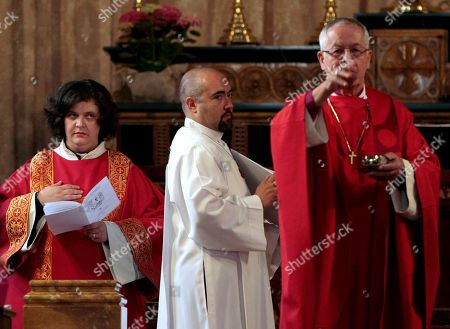 Maria Vittoria Longhitano, left, during the mass at the All Saints Church, in Rome, where she was ordained as the first female priest, of the Italian Old Catholic Church. The Old Catholic Church split from the Holy See in the 1870's over a disagreement with the First Vatican Council promulgating the doctrine of papal infallibility in 1871