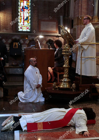 Maria Vittoria Longhitano lies down in front of the altar during a mass at the All Saints Church, in Rome, where she was ordained priest of the Italian Old Catholic Church. The Old Catholic Church split from the Holy See in the 1870's over disagreement with the First Vatican Council promulgating the doctrine of papal infallibility in 1871