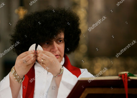 Stock Picture of Maria Vittoria Longhitano Maria Vittoria Longhitano holds the holy host as she celebrates a mass with members of the Women's Ordination Conference at the Anglican church Rome, . Groups that have long demanded that women be ordained Roman Catholic priests took advantage of the Vatican's crisis over clerical sex abuse to press their cause demanding the Vatican open discussions on letting women join the priesthood