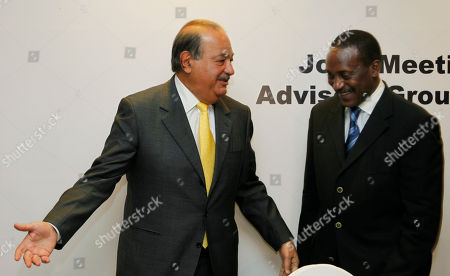 Carlos Slim, Kandeh Yumkella Mexican businessman Carlos Slim, left, and Kandeh Yumkella, head of the UN Industrial Development Organization (UNIDO) leave a press conference following a meeting on energy and climate change in Mexico City