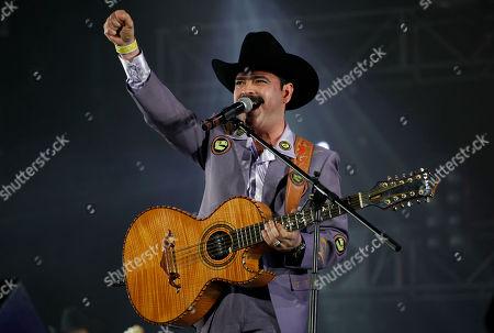 """Mario Quintero Mario Quintero, member of the Mexican music band Los Tucanes de Tijuana, performs during the """"Vive Grupero"""" Mexican folk music festival in Mexico City"""