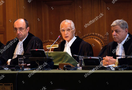 Judge Owada, Peter Tomka, Awn Shawkat Al-Khasawneh President of the court Judge Owada, centre, accompanied by Vice-President of the Court Judge Peter Tomka, left, and Judge Awn Shawkat Al-Khasawneh, right, are seen in the Great Hall of Justice at the World Court in The Hague, Netherlands, . The United Nations' highest court is issuing an advisory opinion on whether Kosovo's 2008 declaration of independence from Serbia was legal, a ruling that could set a precedent for separatist regions around the world