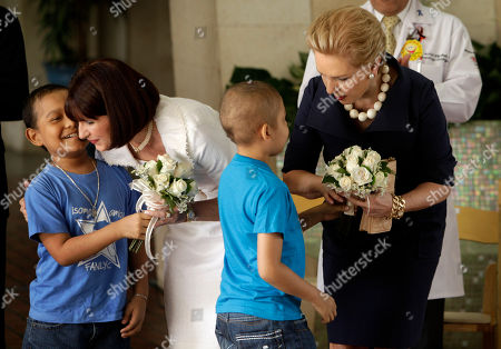 Carolina Herrera, Marta Linares de Martinelli Venezuela's fashion designer Carolina Herrera, right, receives flowers during a ceremony to support the social programs of Panama's First Lady Marta Linares de Martinelli at the oncology hospital in Panama City, . Herrera is in Panama to present next Wednesday, part of her Spring 2010 collection