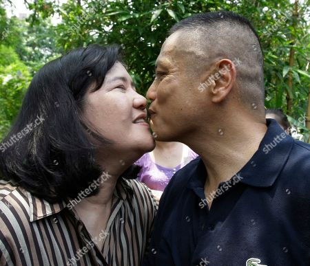 Former Philippine Marine Col. Ariel Querubin kisses his wife Maria Flor after he stseps out of the detention center for his provisional liberty at the headquarters of the Armed Forces of the Philippines in suburban Quezon City north of Manila, Philippines. Querubin was detained for four years after figuring in a failed attempt to overthrow the administration of former President Gloria Macapagal Arroyo