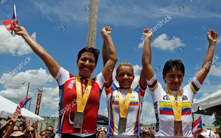 Angie Gonzalez, Marie Rosado, Diana Garcia Gold medalist Angie Gonzalez of Venezuela, center, silver medalist Marie Rosado of Puerto Rico, left, and bronze medalist Diana Garcia of Colombia pose on the podium during the awards ceremony for the women's road race cycling event at the Central American and Caribbean Games Mayaguez 2010 in Lajas, Puerto Rico