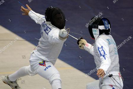 Carlos Rodriguez, Felipe Bonilla Venezuela's Carlos Rodriguez, left, competes against El Salvador's Felipe Bonilla in the fencing men's individual foil event of the Central American and Caribbean Games in Mayaguez, Puerto Rico