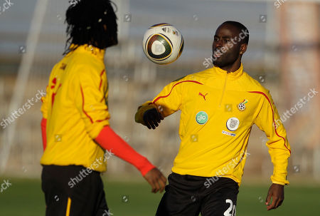 Quincy Owusu Abeyie Ghana's Quincy Owusu Abeyie, right, juggles the ball during a training session in Mogwase, South Africa, . Ghana's national soccer team is preparing for their second Group D World Cup match, against Australia on June 19