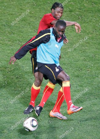 Quincy Owusu-Abeyie, Isaac Vorsah Ghana's national soccer team player Quincy Owusu-Abeyie, front, chalenges for the ball with Isaac Vorsah, during a training session at Loftus Versfeld Stadiun in Pretoria, South Africa, . Ghana will play Serbia in a soccer World Cup Group D match on Sunday