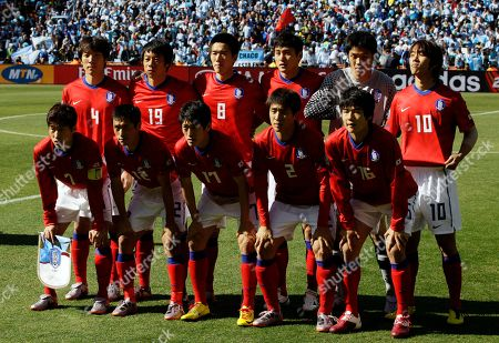The South Korea team, front row from left, Park Ji-sung, Lee Young-pyo, Lee Chung-yong, Oh Beom-seok, Ki Sung-yong, back row from left, Cho Yong-hyung, Yeom Ki-hun, Kim Jung-woo, Lee Jung-soo, goalkeeper Jung Sung-ryong, and Park Chu-young pose for a group photo before the World Cup group B soccer match between Argentina and South Korea at Soccer City in Johannesburg, South Africa
