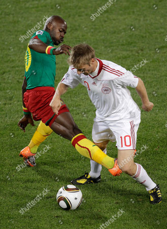 Cameroon's Achille Emana, left, challenges Denmark's Martin Jorgensen during the World Cup group E soccer match between Cameroon and Denmark at the Loftus Versfeld Stadium in Pretoria, South Africa