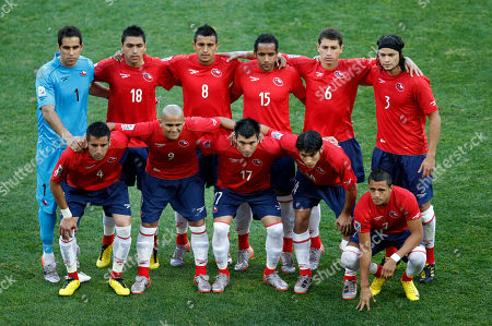 Chile players pose for a team photo prior to the World Cup group H soccer match between Chile and Switzerland at Nelson Mandela Bay Stadium in Port Elizabeth, South Africa, . Back row from left: goalkeeper Claudio Bravo, Gonzalo Jara, Arturo Vidal, Jean Beausejour, Carlos Carmona and Waldo Ponce. Front row from left: Mauricio Isla, Humberto Suazo, Gary Medel, Matias Fernandez, and Alexis Sánchez