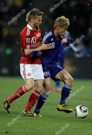 Denmark's Martin Jorgensen, left, Japan's Keisuke Honda during the World Cup group E soccer match between Denmark and Japan at Royal Bafokeng Stadium in Rustenburg, South Africa