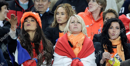 Yolanthe Cabau Van Kasbergen, girlfriend of Wesley Sneijder, left, blows a kiss as she waits with other wives and girlfirends of Netherlands players for the start of the World Cup final soccer match between the Netherlands and Spain at Soccer City in Johannesburg, South Africa