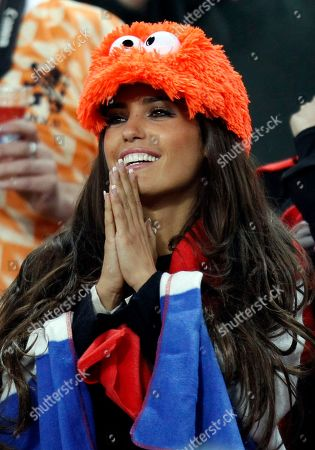Yolanthe Cabau Van Kasbergen, girlfriend of Wesley Sneijder, smiles prior to the World Cup final soccer match between the Netherlands and Spain at Soccer City in Johannesburg, South Africa