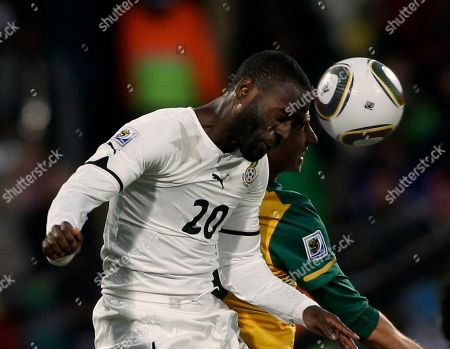 Australia's Luke Wilkshire, right, and Ghana's Quincy Owusu Abeyie, left, jump for the ball during the World Cup group D soccer match between Ghana and Australia at Royal Bafokeng Stadium in Rustenburg, South Africa