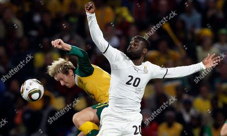 Australia's David Carney, left, and Ghana's Quincy Owusu Abeyie vie during the World Cup group D soccer match between Ghana and Australia at Royal Bafokeng Stadium in Rustenburg, South Africa, on