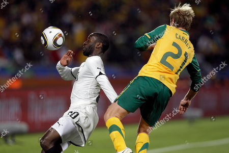 Ghana's Quincy Owusu Abeyie, left, and Australia's David Carney during the World Cup group D soccer match between Ghana and Australia at Royal Bafokeng Stadium in Rustenburg, South Africa, on