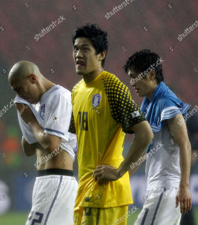 South Korea's Cha Du-ri, left, South Korea goalkeeper Jung Sung-ryong, center, and South Korea's Lee Chung-yong react at the end of the World Cup round of 16 soccer match between Uruguay and South Korea at Nelson Mandela Bay Stadium in Port Elizabeth, South Africa, . Uruguay won 2-1 and advances to the quarterfinals