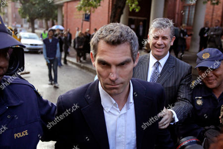 British journalist Simon Wright walk's out of court in the city of Cape Town, South Africa, . The British journalist accused of conspiring in the trespassing act on an England fan who entered the team's dressing room after its draw against Algeria, was ordered to reappear in court next month after being released on 3,000-rand ($390) bail