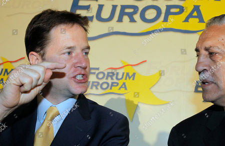 Nick Clegg, Diego Lopez Garrido British Deputy Prime Minister Nick Clegg, left, talks with Spanish Secretary of State for the EU Diego Lopez Garrido, right, during a Nueva Economia Forum in Madrid, on