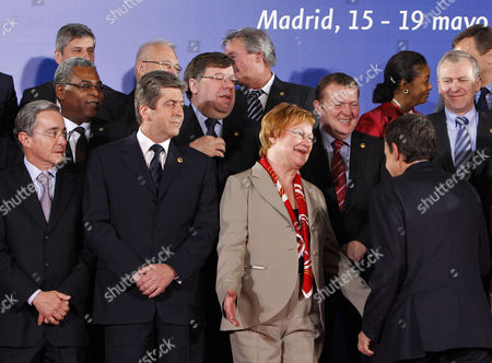 Stock Picture of Tarja Halonen, Jose Luis Rodriguez Zapatero, Alvaro Uribe, Georgi Parvanov, Jean-Max Bellerive, Brian Cowen, Lars Lokke, Yves Leterme, Marlene Malahoo Forte Finland's President Tarja Halonen, bottom third right, gestures as Spain's Prime Minister Jose Luis Rodriguez Zapatero, bottom right, arrives late for the group photo of the EU Latin America summit in Madrid, on . Bottom row from left: Colombian President Alvaro Uribe, Bulgarian President Georgi Parvanov, Finland's President Tarja Halonen, and Spain's Prime Minister Jose Luis Rodriguez Zapatero. Middle row from left: Haitian Prime Minister Jean-Max Bellerive, Irish Prime Minister Brian Cowen, Danish Prime Minister Lars Lokke and Belgium Prime Minister Yves Leterme. Top row, second right is Jamaica's junior foreign minister Marlene Malahoo Forte