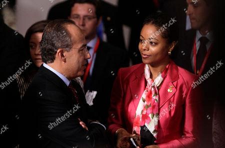 Marlene Malahoo Forte, Felipe Calderon Mexican President Felipe Calderon, left, talks to Jamaica's junior Foreign Minister Marlene Malahoo Forte, right, during the group picture of the EU Latin America summit, in Madrid, on
