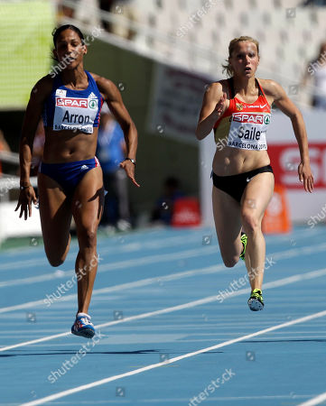 France's Christine Arron, left, and Germany's Verena Sailer compete in a Women's 100m heat, during the European Athletics Championships, in Barcelona, Spain