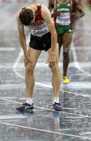 Germany's Arne Gabius reacts after a Men's 5000m heat during the European Athletics Championships, in Barcelona, Spain