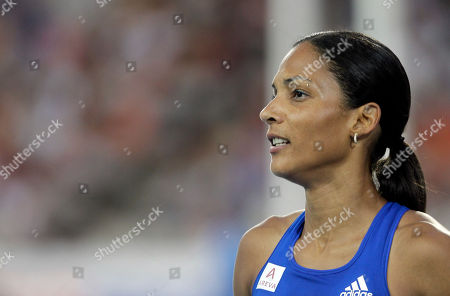France's Christine Arron reacts after a Women's 100m semifinal during the European Athletics Championships, in Barcelona, Spain