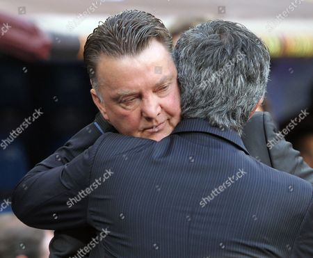 Inter Milan's coach Jose Mario dos Santos Felix Mourinho from Portugal, back to camera, exchanges words with Bayer Munich's coach Louis Van Gaal during the Champions League final soccer match at the Santiago Bernabeu stadium in Madrid, Spain