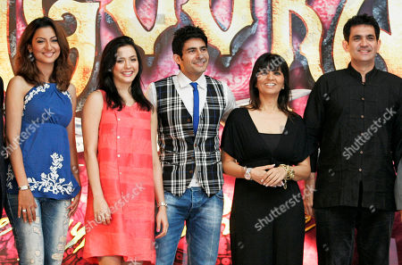 """Gauahar Khan, Isha Sharvani, Hussain Kuwajerwala, Neeta lulla, Omung Kumar Bollywood actors, from left, Gauahar Khan, Isha Sharvani, Hussain Kuwajerwala, with fashion designer Neeta lulla, second right, and art director Omung Kumar pose for a photographers during a press conference to announce the Bollywood musical """"Zangoora -the Gypsy Prince"""", at the International Indian Film Academy (IIFA) awards event in Colombo, Sri Lanka, . Some of India's top movie stars converged in Sri Lanka on Thursday for Bollywood's annual roadshow despite calls to boycott the event because of the alleged killing of Tamil civilians during the final stages of the country's decades-long civil war"""
