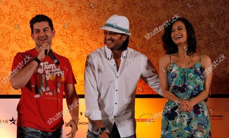 Bollywood actors Neil Nitin Mukesh, left, Ritesh Deshmukh, center, and Dia Mirza share a light moment during a media briefing in Colombo, Sri Lanka, . Some actors and directors from India's southern state of Tamil Nadu had asked Bollywood stars to boycott the event, citing alleged killings by Sri Lankan forces of ethnic Tamil civilians as the island's 25-year civil war wound down last year