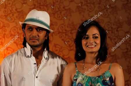 Ritesh Deshmukh, Dia Mirza Bollywood actors Ritesh Deshmukh, left, and Dia Mirza look on during a media briefing in Colombo, Sri Lanka, . Some of India's top movie stars converged in Sri Lanka on Thursday for Bollywood's annual roadshow despite calls to boycott the event because of the alleged killing of Tamil civilians during the final stages of the country's decades-long civil war