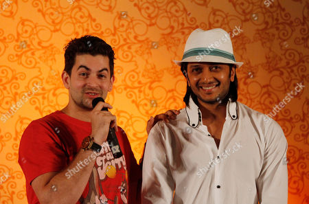 Bollywood actors Neil Nitin Mukesh, left, and Ritesh Deshmukh address a media briefing in Colombo, Sri Lanka, . Some of India's top movie stars converged in Sri Lanka on Thursday for Bollywood's annual roadshow despite calls to boycott the event because of the alleged killing of Tamil civilians during the final stages of the country's decades-long civil war
