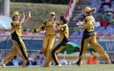 Rene Farrell, Jessica Cameron, Alyssa Healy, Alex Blackwell Australia's bowler Rene Farrell, second right, celebrates with teammate Jessica Cameron, left, wicketkeeper Alyssa Healy, second left, and Alex Blackwell after taking the wicket of India's opener Sulakshana Naik at a Twenty20 Cricket World Cup women semi final match in Gros Islet, St. Lucia